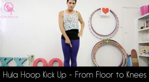 Kick up a hula hoop from a floor.